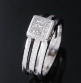 Moderner Diamant- und Brillantring aus 18 kt. Weißgold, zus. 0.75 ct. G/VS