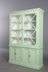 Two-section display cabinet with green paint finish