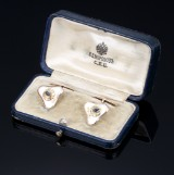 A pair of Russian cufflinks with sapphires and white guilloche enamel. With box. 20th century-first half (2)
