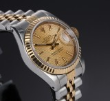 Rolex 'Datejust'. Ladies watch, 18 kt. gold and steel with champagne-coloured dial, c. 1987