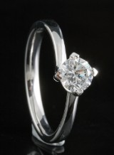 Ring in 18k set with a brilliant cut diamond 0.63 ct