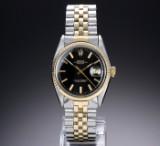 Rolex 'Datejust'. Herrenuhr aus 18 kt. Gelbgold und Stahl mit schwarzem Zifferblatt, ca. 1970