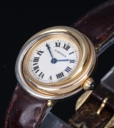 Cartier 'Trinity Trois Ors'. Ladies watch, 18 kt. tricolour gold with original strap and clasp