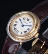 Cartier 'Trinity Trois Ors'. Dameur i 18 kt. trefarvet guld med lys skive, ca. 2000