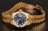 Ladies watch, Rolex Oyster Perpetual Datejust, 18k, with diamonds and sapphires
