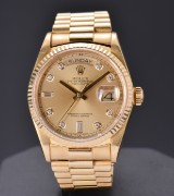 Rolex Day-Date, men's watch, 18 karat gold, with diamanter