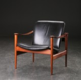 Fredrik A. Kayser. Easy chair, model 711, rosewood and black leather