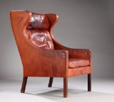 Børge Mogensen. Wing chair, patinated leather