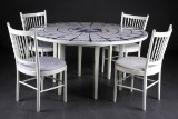 Bjørn Wiinblad. Large round dining table and four chairs (5)