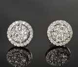 Pair of diamond ear studs in gold, approx. 0.97 ct. (2)
