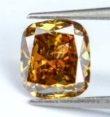 Sjælden Fancy intens orangegylden diamant, 0.78 ct.