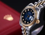 Rolex 'Datejust'. Ladies watch, 18 kt. gold and steel with diamond dial, c. 1992