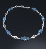 Vintage sapphire and diamond necklace, 18 kt. white gold, sapphires, total approx. 84.00 ct. diamonds total approx. 4.70 ct.
