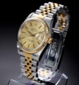 Rolex 'Datejust'. Herreur i 18 kt. guld og stål med champagnefarvet skive, ca. 1989