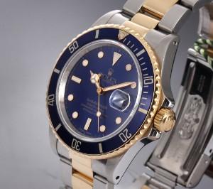 Nye og brugte herreure - Rolex, Cartier, Omega, Breitling - Rolex Submariner. Herreur i 18 kt ...