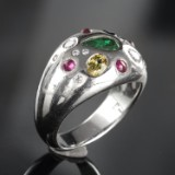 White gold ring featuring brilliant-cut diamonds and gemstones