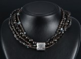 Ole Lynggaard. Lace clasp, 18 kt. white gold with diamonds, three necklaces (4)