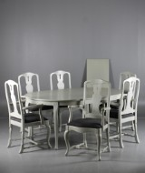 Åmells. Dining table with extension leaves and six armchairs (9)