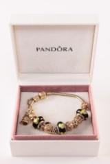 Pandora armbånd i guld med guldcharms 37,3 gr. (15)