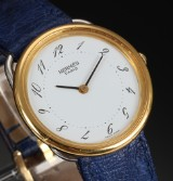 Hermès 'Arceau'. Ladies watch, gold and steel with white dial, c. 2009