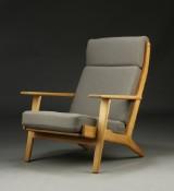 H. J. Wegner. Højrygget hvilestol, massivt egetræ