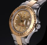 Rolex 'Yacht-Master Lady'. Ladies watch, 18 kt. gold and steel with champagne-coloured dial, c. 2000