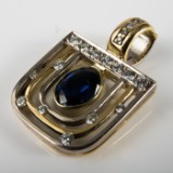A one-off pendant, 750 gold, bicolor, 1 sapphire 3.50ct. and 19 diamonds