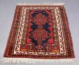 Orientalsk tæppe, 123 x 88 cm.