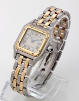 Cartier Panthere. Ladies watch, 18 kt. gold and steel with sapphires