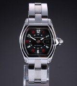 Cartier 'Roadster'. Men's watch, steel, with black dial - box + receipt 2002
