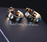David Chu for Georg Jensen. 'Moonrise' earrings, 18 kt. gold with blue topazes (2)