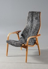 Yngve Ekström. Lamino easy chair, dark-grey sheep skin