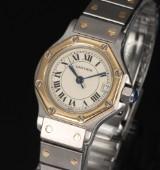 Cartier Santos. Dameur i 18 kt. guld og stål med lys skive med dato