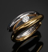 Ole Lynggaard. 'Kysset' ring, 18 kt. white and yellow gold, with an 0.30 ct. diamond