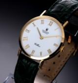 Rolex 'Cellini'. Herreur i 18 kt. guld med hvid skive, ca. 1989