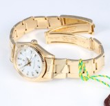 Rolex 'Datejust'. Mid-size watch, 18 kt. gold with white dial, c. 1978