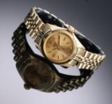Rolex 'Oyster Perpetual'. Vintage dameur i 18 kt. guld med champagnefarvet skive, ca. 1964