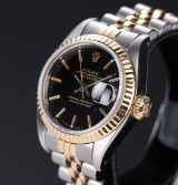 Rolex 'Datejust'. Ladies watch, 18 kt. gold and steel with black dial, c. 1987