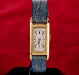Cartier 'Lady'. Vintage ladies watch, 18 kt. gold with pale dial, c. 1950s