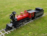 Garden railway with locomotive and wagons
