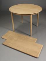 Skovmand & Andersen. Cirkulært spisebord, egetræ