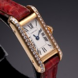 Cartier 'Tank'. Ladies watch, 18 kt. gold with diamonds