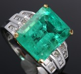 Diamond ring, platinum and 18 kt. gold with faceted emerald