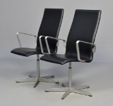 Arne Jacobsen. Pair of Oxford armchairs, black leather, 2008 (2)