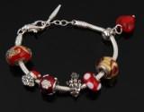 Bacio, Italien. Armbånd med 7 charms, nogle med julemotiver, sterlingsølv