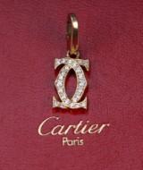 Cartier. 'Logo' charm, 18 kt. gold, brilliant-cut diamonds - box + cert.
