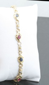 Ruby, Sapphire diamond bracelet 18kt. approx. 0.15ct