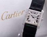 Cartier 'Tank Francaise'. A large ladies watch, 18 kt. white gold with diamonds