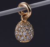 Ole Lynggaard. 'Sweet Drop' charm, 18 kt. red gold with 1.98 ct. of diamonds