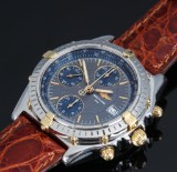 Breitling 'Chronomat'. Men's watch, 18 kt. gold and steel with grey dial, 1990s